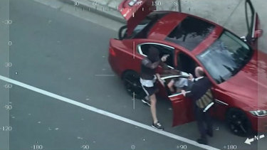 Vision from a police helicopter shows Patrick McMillan carjacking a female driver in Ivanhoe.
