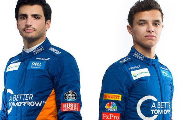 McLaren drivers Carlos Sainz and Lando Norris in racegear with the 'A Better Tomorrow' slogan