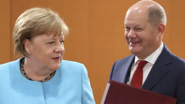German Chancellor Angela Merkel, of the Christian Democrats, and Finance Minister and Vice-Chancellor Olaf Scholz, of the Social Democrats.