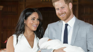 Harry and Meghan, the Duke and Duchess of Sussex, with their newborn son in St George's Hall at Windsor Castle in May.