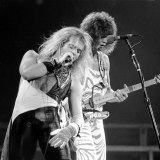 Van Halen's David Lee Roth (left) and lead guitarist  Eddie Van Halen on stage in Philadelphia, 1982.