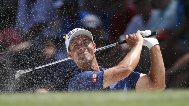 Adam Scott sits five shots back of clubhouse leader Gary Woodland.