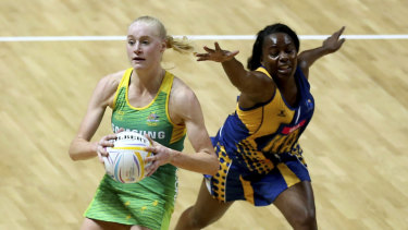 On a roll: Jo Weston helps Australia to their fourth win in as many games at the World Cup.