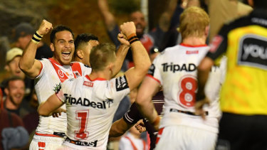 Close call: The Dragons celebrate at full-time.