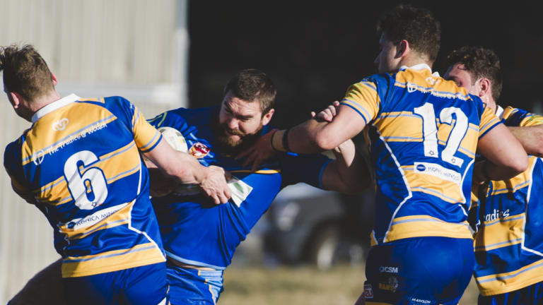 Rams Sean Maloney and Michael Gilmour stop West Belconnen's Fraser Harvey in his tracks.