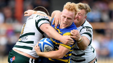 Rookie of the year: Sydney University's Will McDonnell is tackled in the Shute Shield grand final.