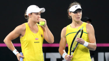 Game plan: Australian Ashleigh Barty and Samantha Stosur discuss tactics during the decisive doubles against France.