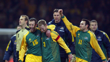 Lucas Neill and Craig Moore during the height of the Golden Generation, celebrating the Socceroos' friendly win over England at Upton Park in 2003.