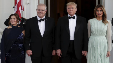 Prime Minister Scott Morrison and his wife Jenny are greeted by US President Donald Trump and his wife Melania before the state dinner.