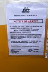 The notice of arrest on the Monster Project.