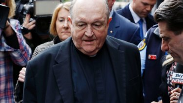 Former archbishop Philip Wilson outside Newcastle Local Court in July.