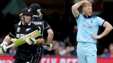 England's Ben Stokes, right, reacts after a boundary hit by New Zealand's James Neesham, centre, during the Cricket World Cup final.