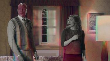 Elizabeth Olsen as Wanda Maximoff and Paul Bettany as VIsion in WandaVision.
