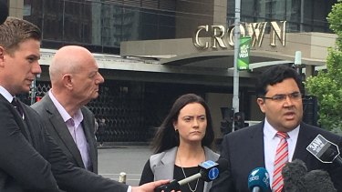 "Tim Costello (second from left) at a press conference outside Crown Casino in 2016 with Shonica Guy. Her case that the casino's ""Dolphin Treasure"" poker machines fed gambling addictions ultimately failed."
