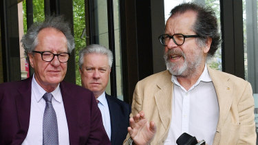 Geoffrey Rush with theatre director Neil Armfield, right, outside the Federal Court on Wednesday.