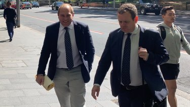 Jamie Clements, left, arrives at an ICAC inquiry on Thursday.