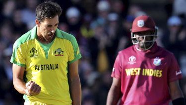 Mitchell Starc celebrates the dismissal of West Indies' captain Jason Holder.