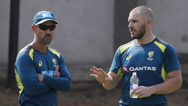 Australian coach Justin Langer with one-day skipper Aaron Finch.