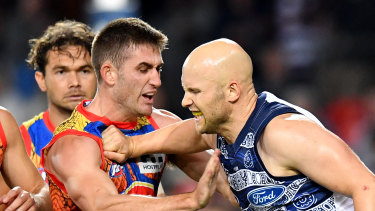 Gary Ablett scuffles with Gold Coast's Anthony Miles.