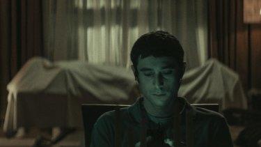 Yakov (Dave Davis) sits in front of the body ofMr Litvak in horror film The Vigil.