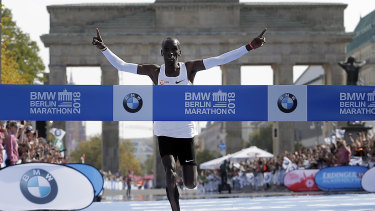 Record breaker: Eliud Kipchoge smashes the world marathon mark by almost 80 seconds.