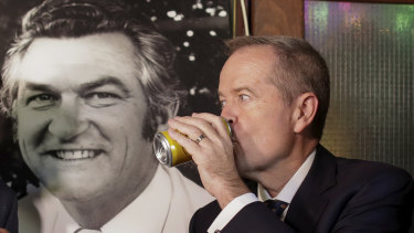 Opposition Leader Bill Shorten has a beer (Hawke's Patio Ale) in memory of former PM Bob Hawke at the John Curtin Hotel in Melbourne on Friday.