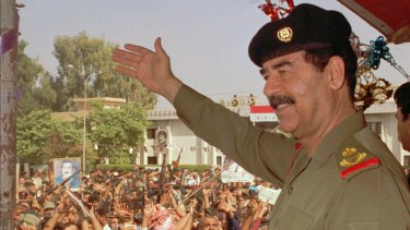 Then Iraqi president Saddam Hussein waves to supporters in Baghdad in 1995.