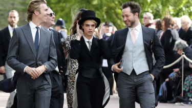 Cara Delevingne caused a stir with her royal wedding suit.