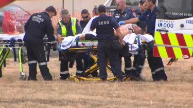 Tony Mokbel is treated by paramedics outside the prison.