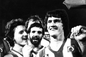 Kerry Good (right) the man who kicked the winning goal, was the dressing room hero for North Melbourne.