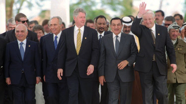Egyptian President Hosni Mubarak with world leaders including US President Bill Clinton at the March 13, 1996, Summit for Peacemakers in Egypt.