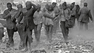 People make their way amid debris after the attack on the World Trade Centre in New York 20 years ago.