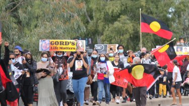 Crowds march through Moree in July to protest against the police response to Copeland's disappearance.