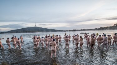 Participants in Canberra's 2018 Winter solstice nude charity swim raised money for local charities Lifeline Canberra and Love your sister by taking a plunge in Lake Burley Griffin on a -3 degree morning.