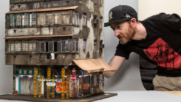 Joshua Smith working on one of his Hong Kong miniatures.