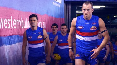 Daniel Cross walks out on to the ground  to face the Demons in 2013.