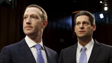 Mark Zuckerberg, Facebook's chief executive, and Joel Kaplan, its vice-president of global public policy, arrive to testify on Capitol Hill in Washington.