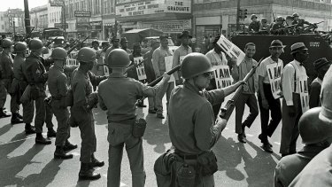 Looking to the past: Striking workers marching past National Guard troops with bayonets during a civil rights march in 1968 in Memphis, Tennessee.