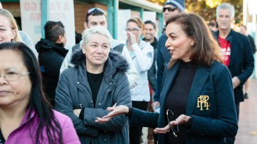 Labor candidate for Cowan Anne Aly talking to voters at Landsdale Primary School in Perth's northern suburbs.
