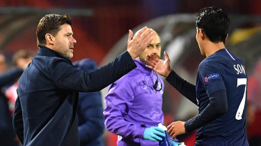 The end nears: Pochettino congratulates Heung-Min Son on scoring during the UEFA Champions League group B match between Crvena Zvezda and Spurs at Rajko Mitic Stadium on November 6.