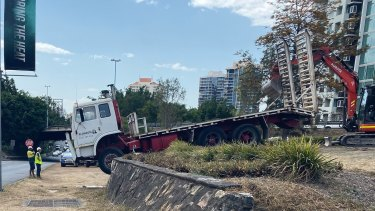 The cabin of the truck appeared to be wedged off the ground in Woolloongabba, just south of the Story Bridge.