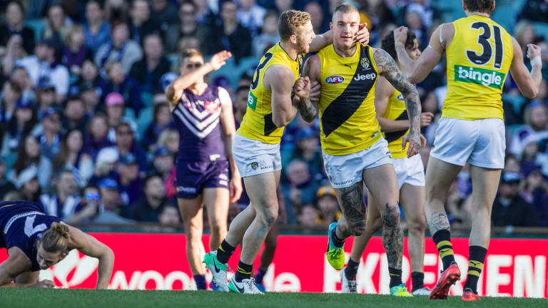 Richmond and Dustin Martin celebrate during the round 22 thrashing of Fremantle at Subiaco Oval.