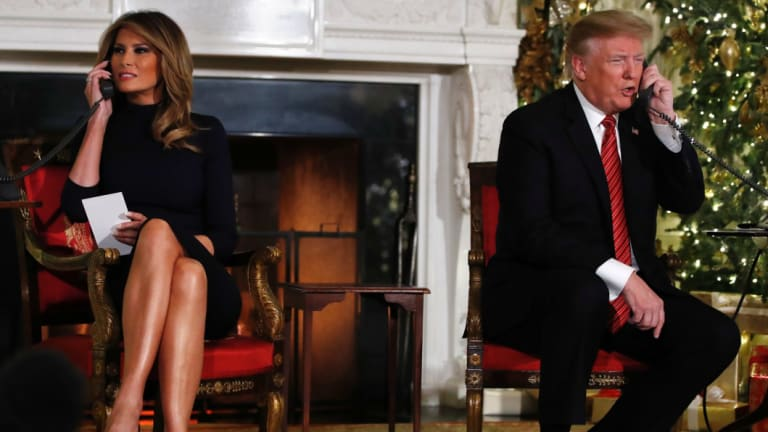 President Donald Trump and first lady Melania Trump speak to children about Santa's movements on Christmas Eve.