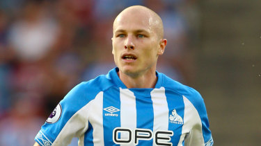 Sidelined: Huddersfield's Aaron Mooy will miss Australia's clash with Kuwait.