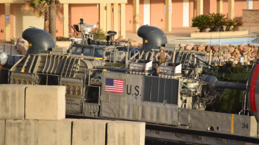 A US amphibious hovercraft prepares to depart with evacuees from Janzur, west of Tripoli, Libya.