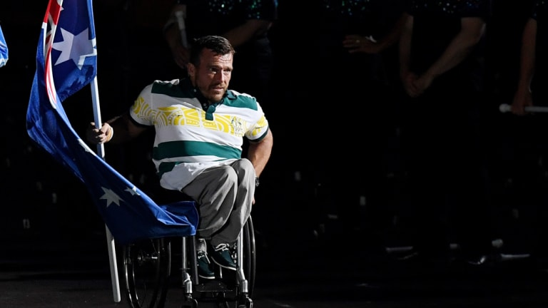 Final act?:  Kurt Fearnley  brings the Australian flag into the Olympic Stadium for the closing ceremony in Sydney. Will this be the last Australia sees of the Games?