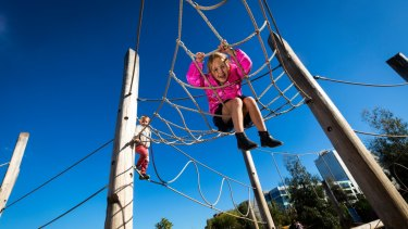 Children at Melbourne's award-winning Royal Park Nature Playground.