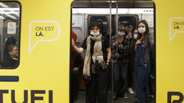 Protesters wear masks and scarves to oppose a law banning people with face coverings from using public transport or working as public employees in  Quebec in 2017. A judge later suspended that law.