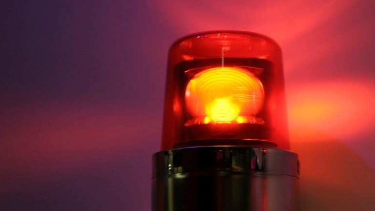 Cars must slow down to 40km/h to pass stopped emergency vehicles with flashing lights.