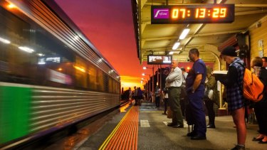 Commuters waiting at Gisborne station for a V/Line train from Bendigo.